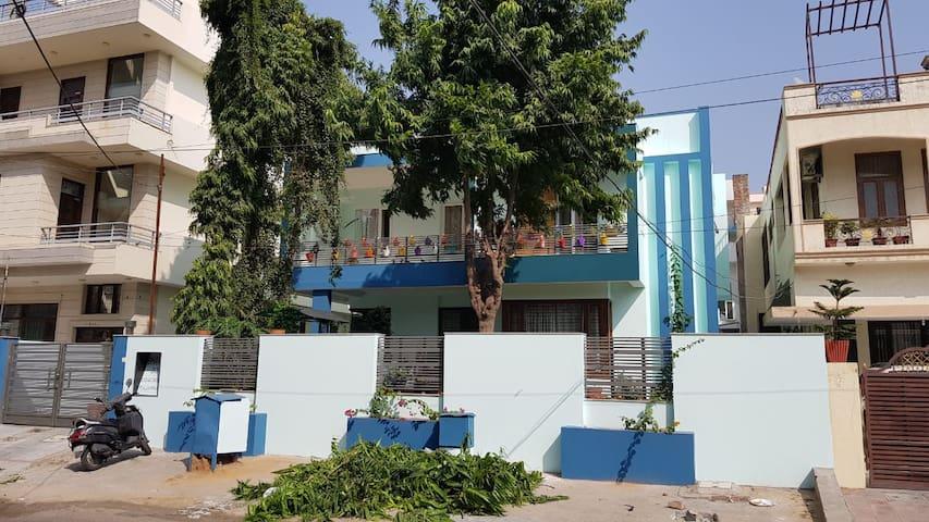 The Blue House - A family home cum Plant Nursery.