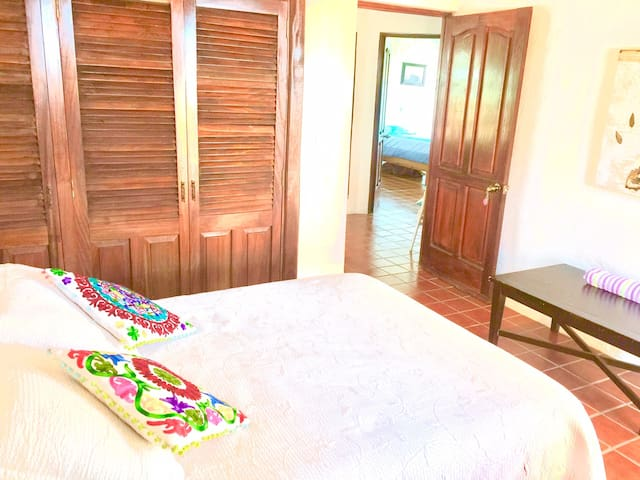 Guest Bedroom 3 with double bed, private balcony and shared bedroom on second floor
