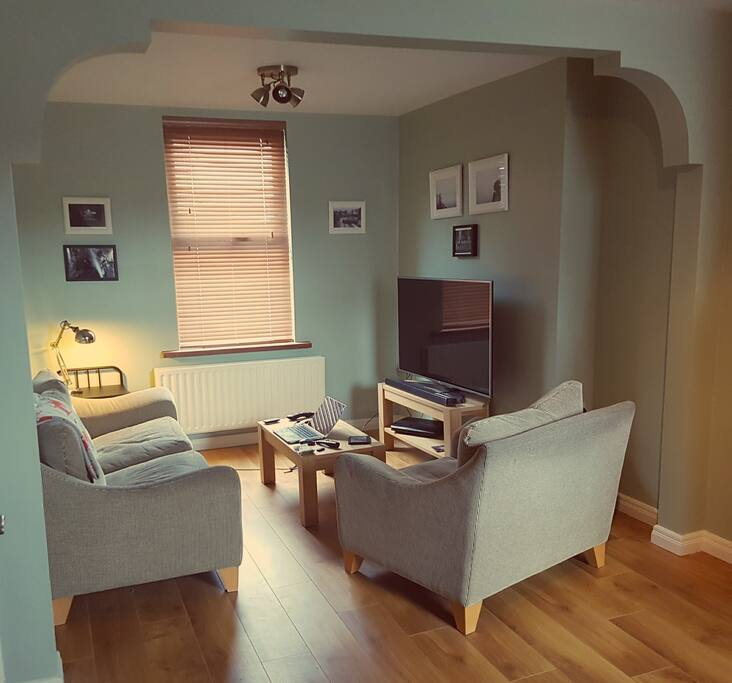 Living Room, with huge TV, fireplace and lounging area