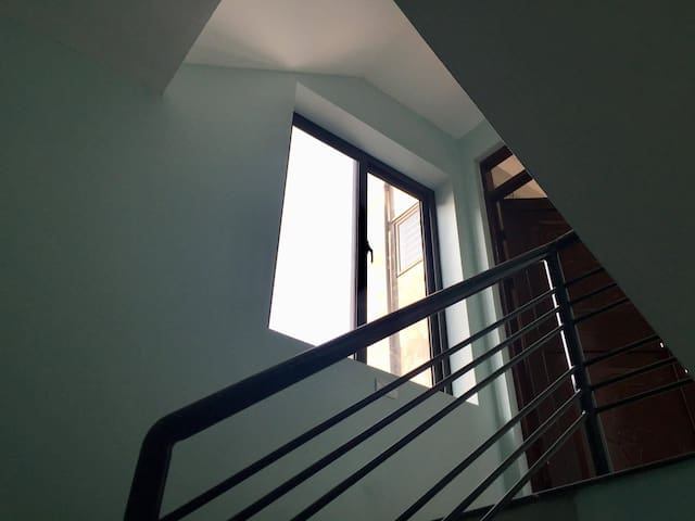 staircase lead to 4th floor apartment
