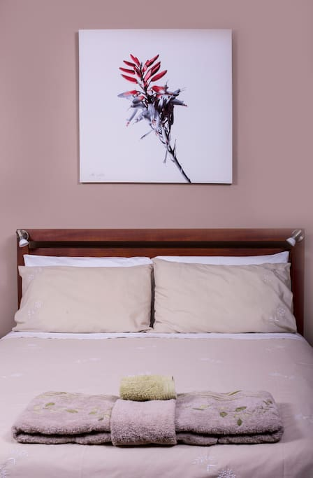 Comfortable double bed with crisp linen.