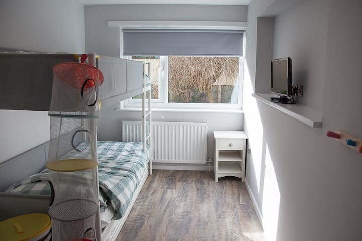 bedroom 4 at rear of house with bunk beds and trundle bed, sleeps 3 persons.