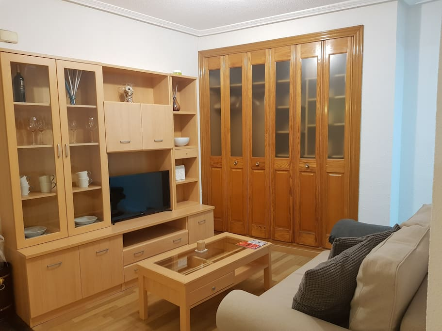 Livingroom with tv, inbuild wardrobe and couch-bed