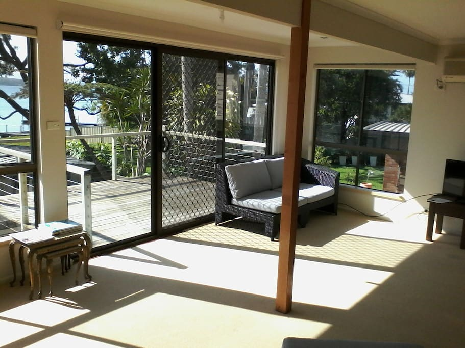 large living room and deck