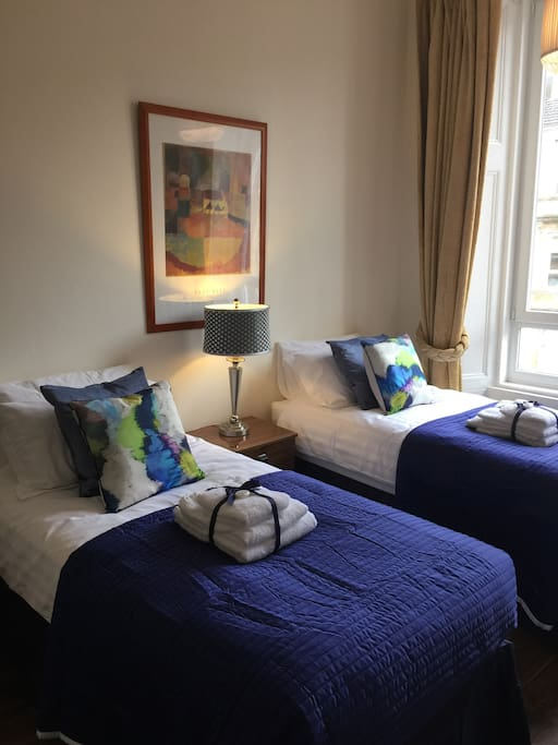 Front Bedroom with two single beds that at Guests request can be changed over to a super King Size Double Bed. The sun will rise and stream through in the morning.