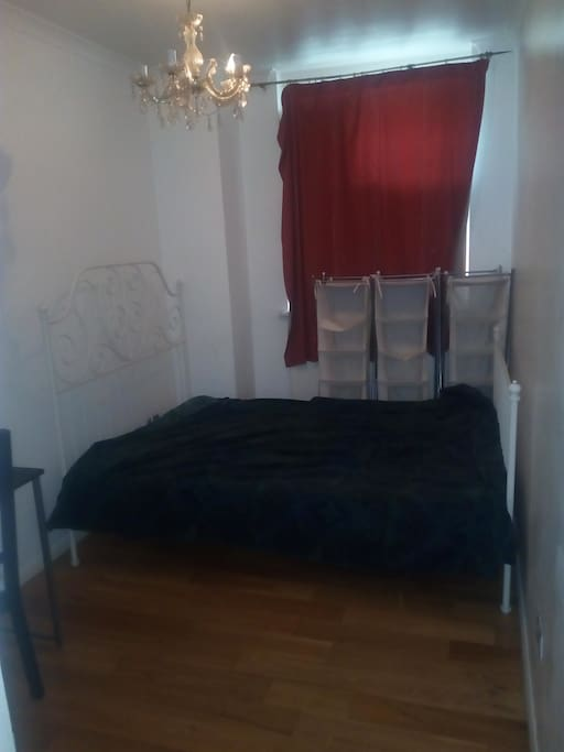 The room with double bed, desk, chair and wardrobe.