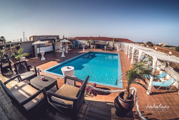 Babalogo Apartments & Poolbar