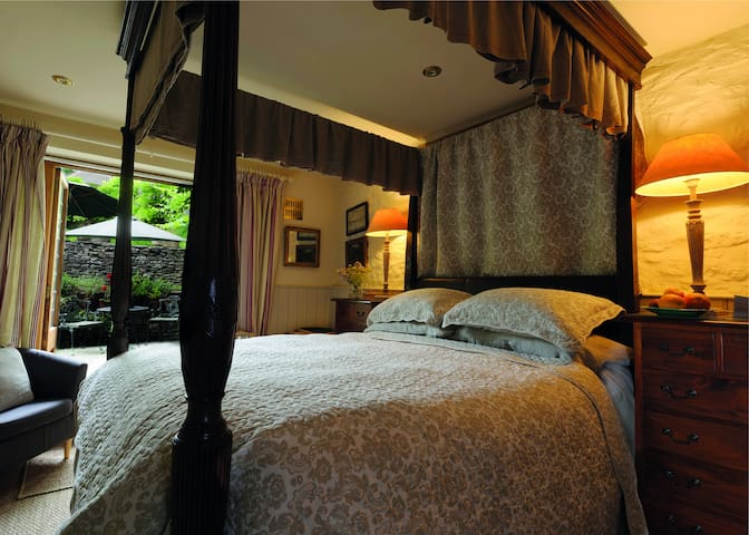 Garden Four Poster Room The ground floor bedroom has a private courtyard garden with table & chairs. Tea, coffee & refreshments are supplied plus a  fridge with fresh milk. A private shower room comes with luxurious toiletries. TV & wifi.