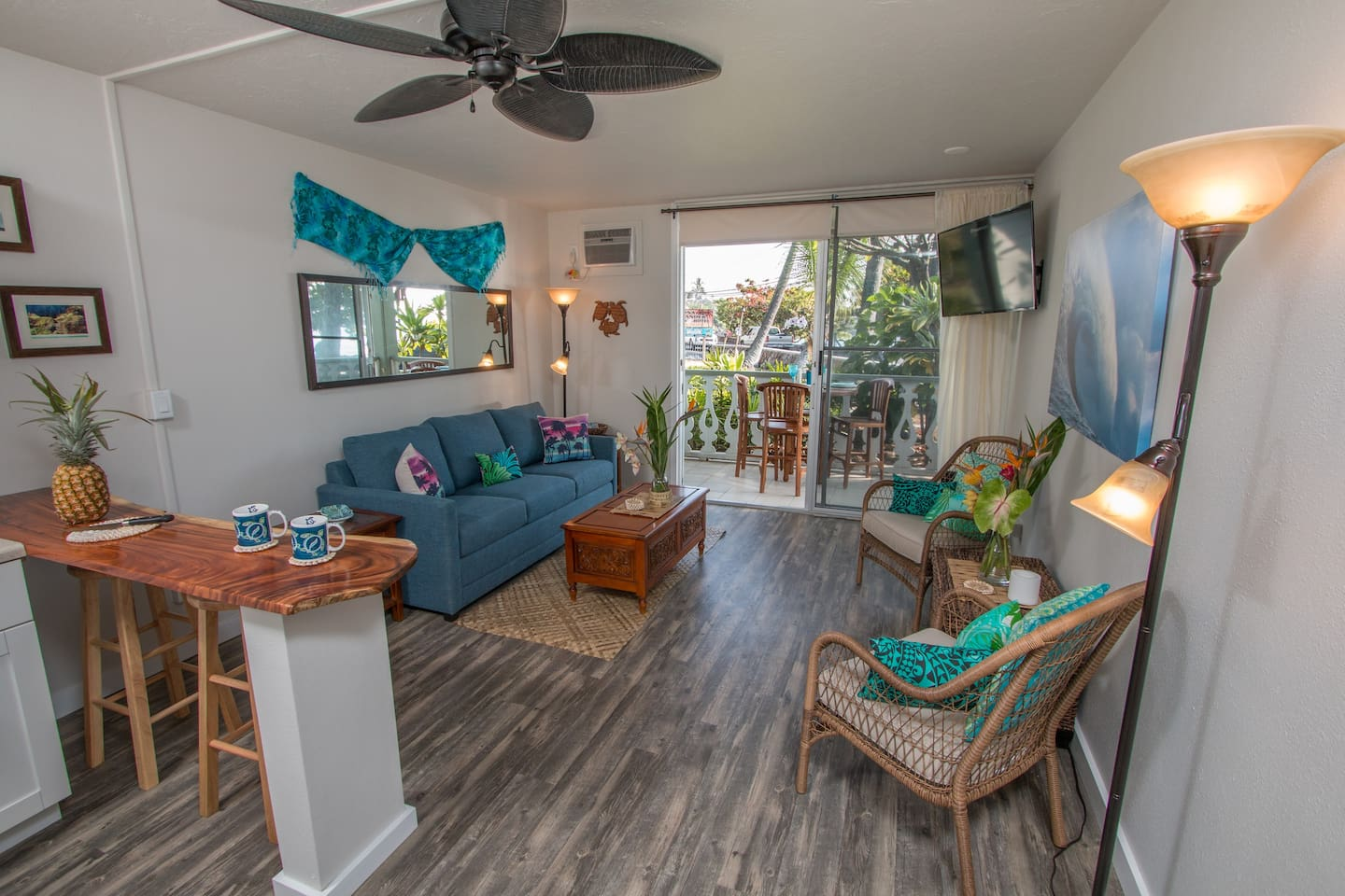 Ocean breezes enhance the natural flow of the interior, accented with blues and greens to organically blend the inside with the magnificent colors outside.