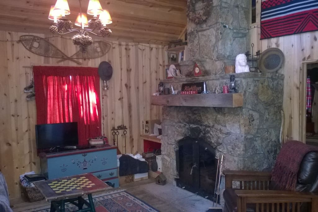 Cozy up to the large rock fireplace and watch a movie.