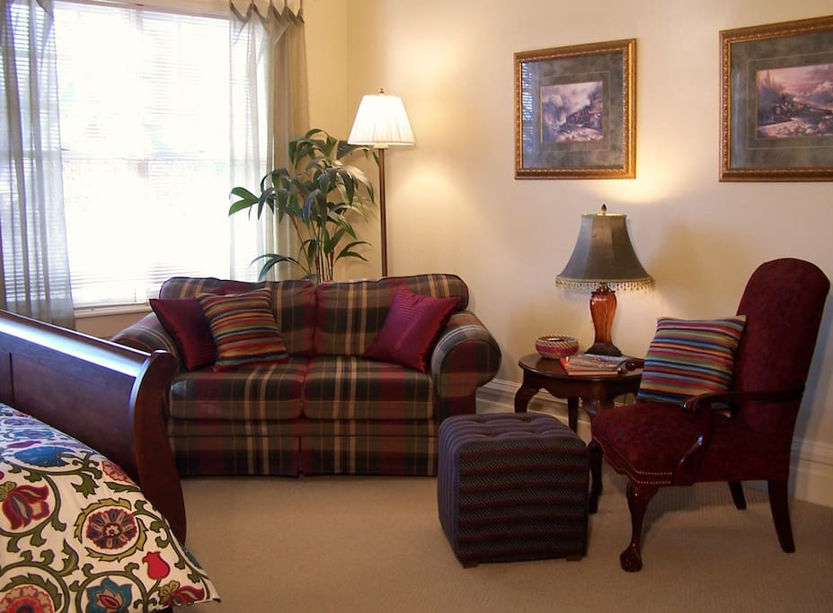 A comfortable sitting area allows guests to watch TV, chat with one another  or just read.