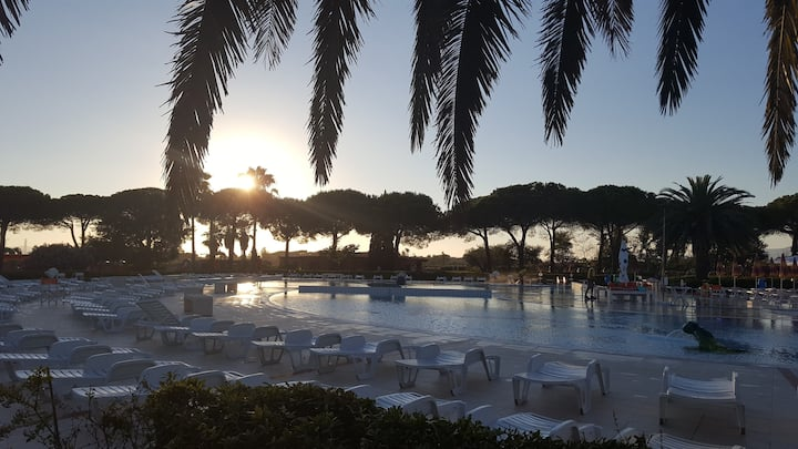 Toscana, piazzola+roulotte in camping PAPPASOLE