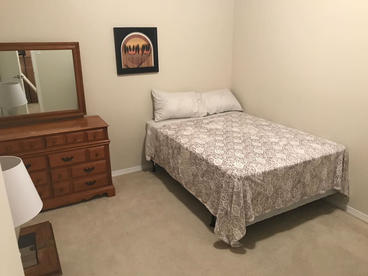 Room B. Full bed, dresser with mirror, office chair, HDTV, cable