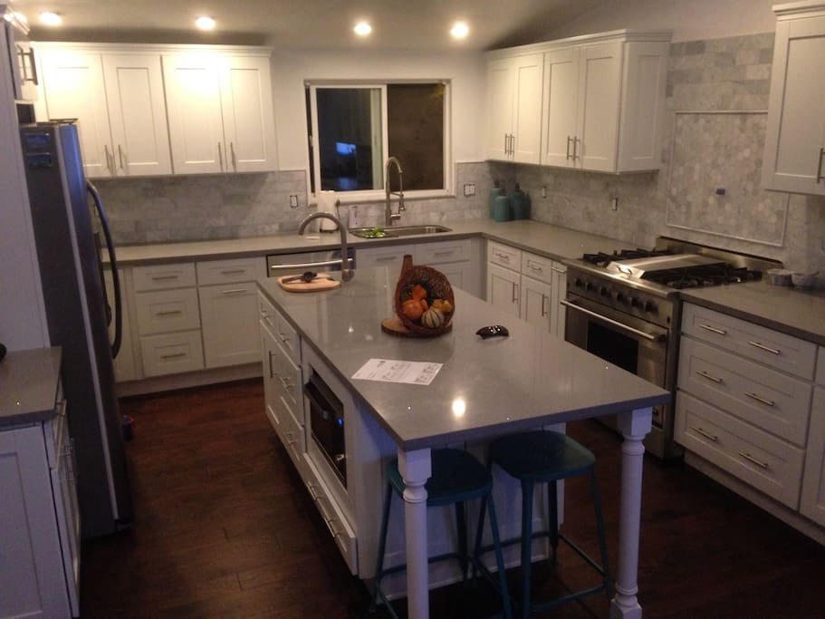 Beautiful chefs kitchen with eat in breakfast bar.