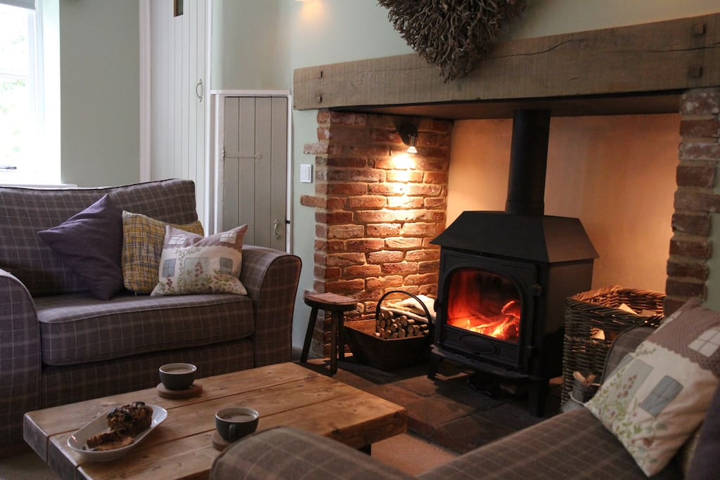 Lounge area with amazing log burner and VERY comfy sofas!