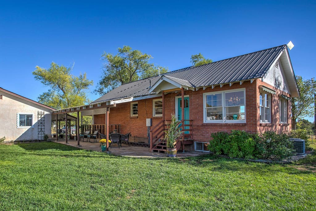 Situated on 5 acres, this farmhouse offers an abundance of outdoor space.