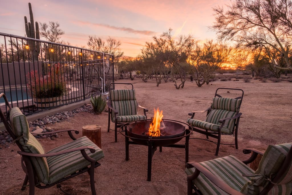 Enjoy the night air around the fire pit while watching the sun set behind the palo verde trees.