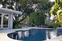 Heated Saltwater Pool with Hot tub and Resort style backyard. Blend of sun and shade so everyone is comfortable