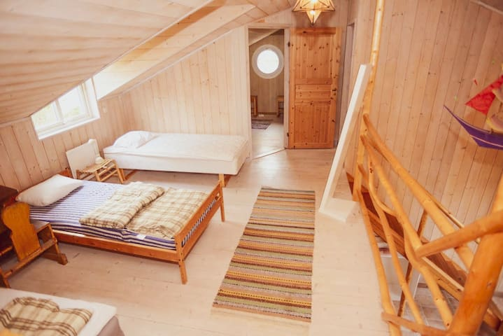4 beds in the tower house and another doubleroom with a forest view and parking area