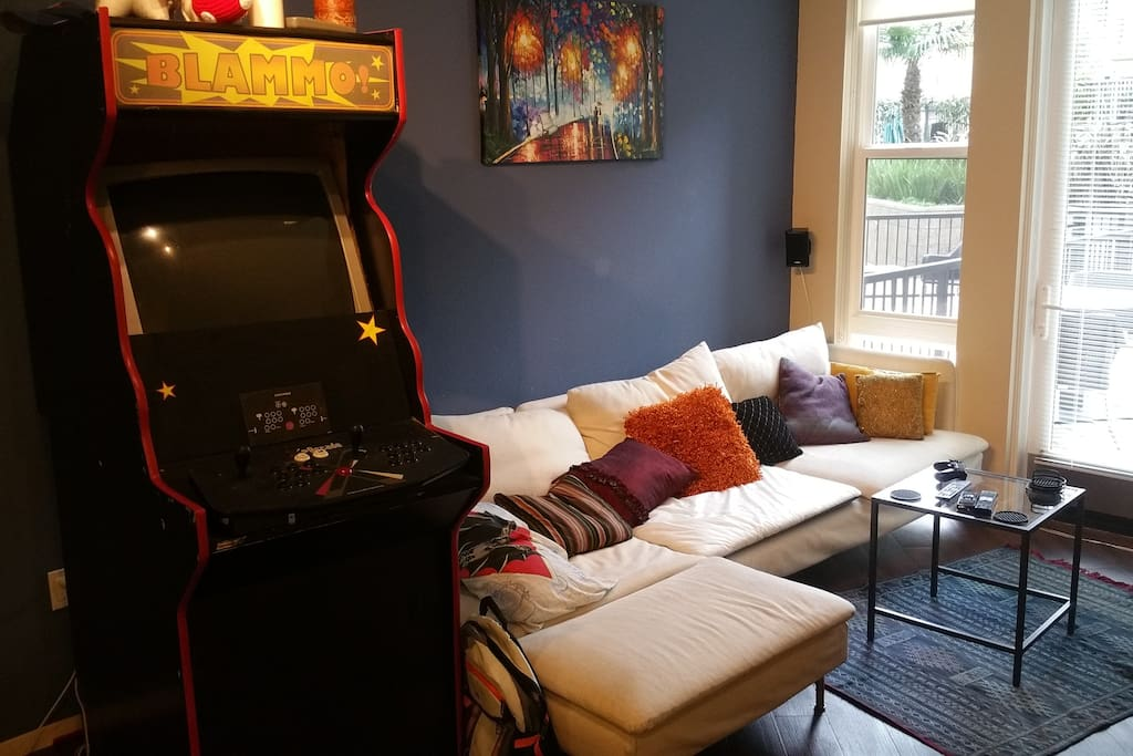 Homemade arcade and long couch.