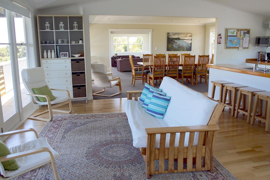 Huge open-plan living areas leading to full length upstairs deck with views over Waiheke