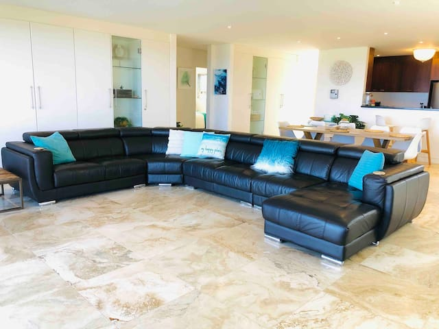The recently updated large leather lounge and cuddly cushions could have you drifting off to sleep while kicking back and watching the Smart TV with streaming and Apple TV, tidily hidden away in the cupboard. 7 seats allow easier social distancing.