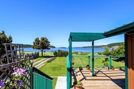 Unique waterfront home with lake & ocean views plus private sauna!