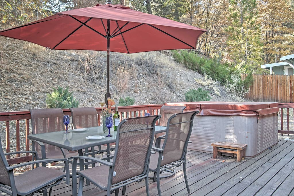 The cabin offers a furnished deck and private hot tub!