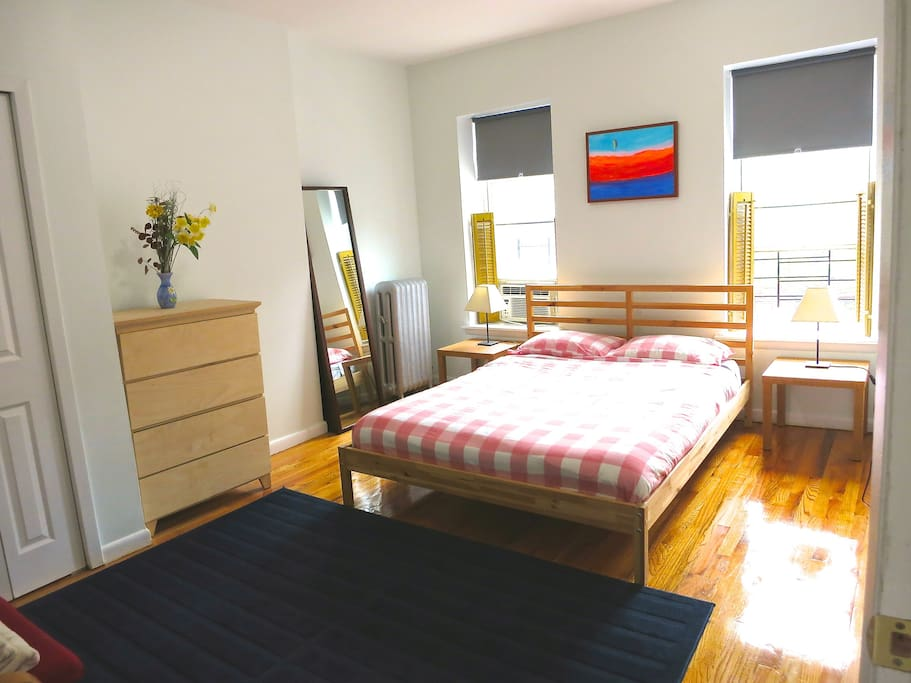 large bedroom with queen sized bed