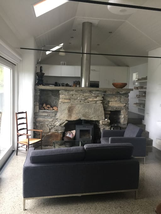 The large kitchen/dining has a living area with wood burning stove