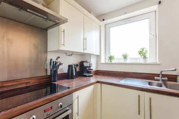 Kitchen which overlooks the secure car parking area