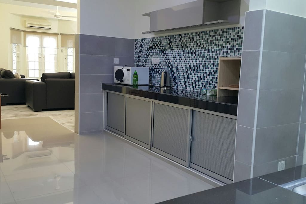 Newly Renovated kitchen. With microwave, electric water kettle & storage cabinet