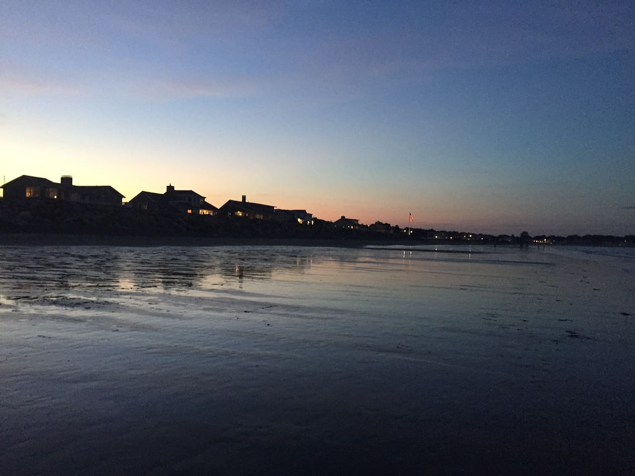 Sunset walks on the beach at low tide