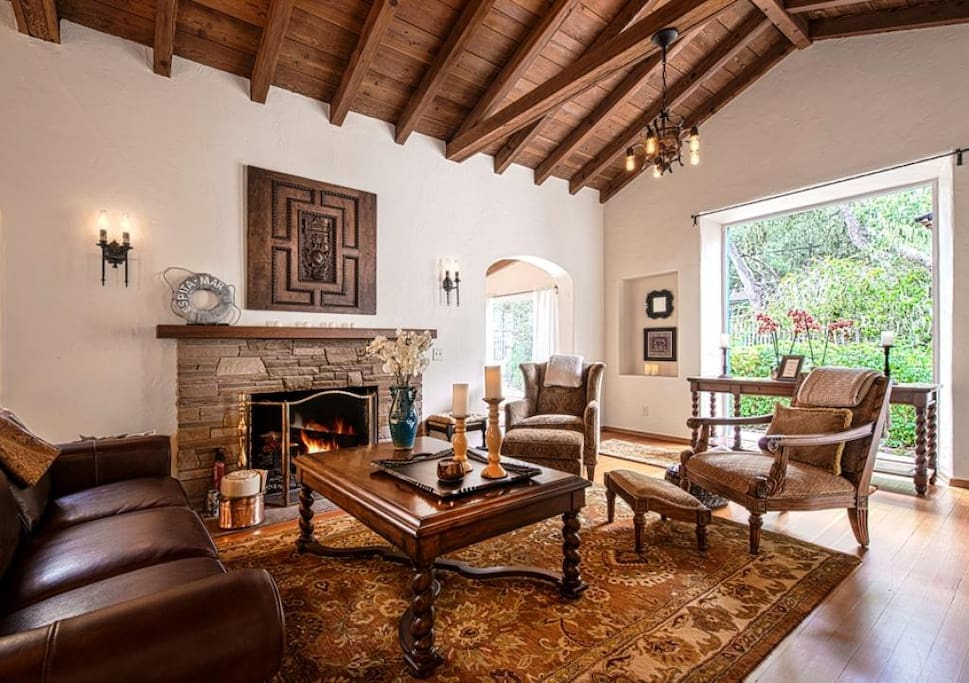 Living Room has Gas Fireplace and Period Light Fixtures