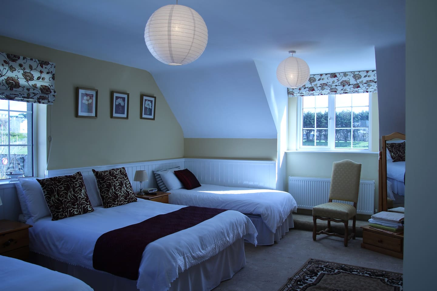 Family room contains 1 double bed and 3 singles plus private bathroom.