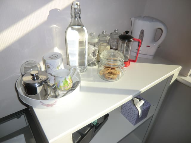 Tea and coffee can be found in the room