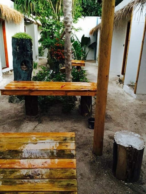 Wooden Comfortable Tables and Chairs Inside Guest House...