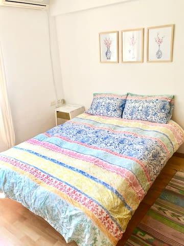room withcomfortable double bed, large closet, arm chair and console