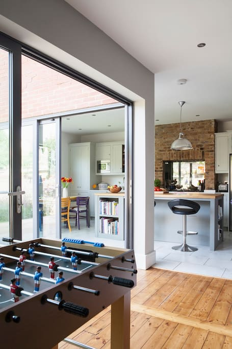 Large glass sliding doors to patio and garden
