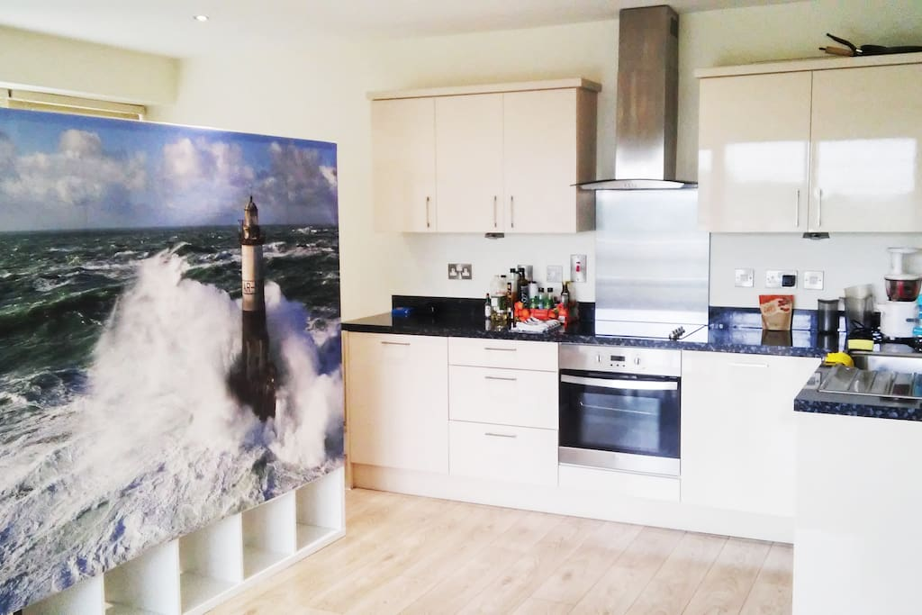 The  fully-equiped American kitchen and the entrance of your open bedroom