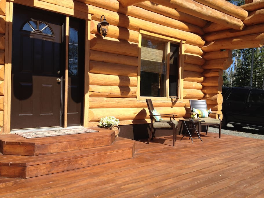 Spacious South facing deck with patio furniture and propane BBQ