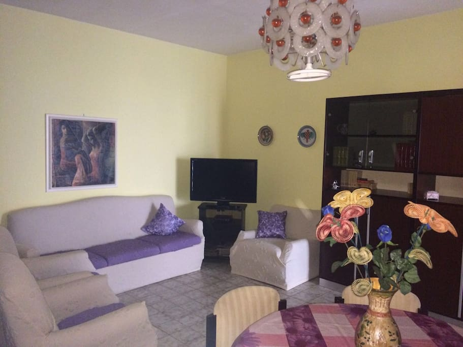 Living room with 4 sofabed and tv flat