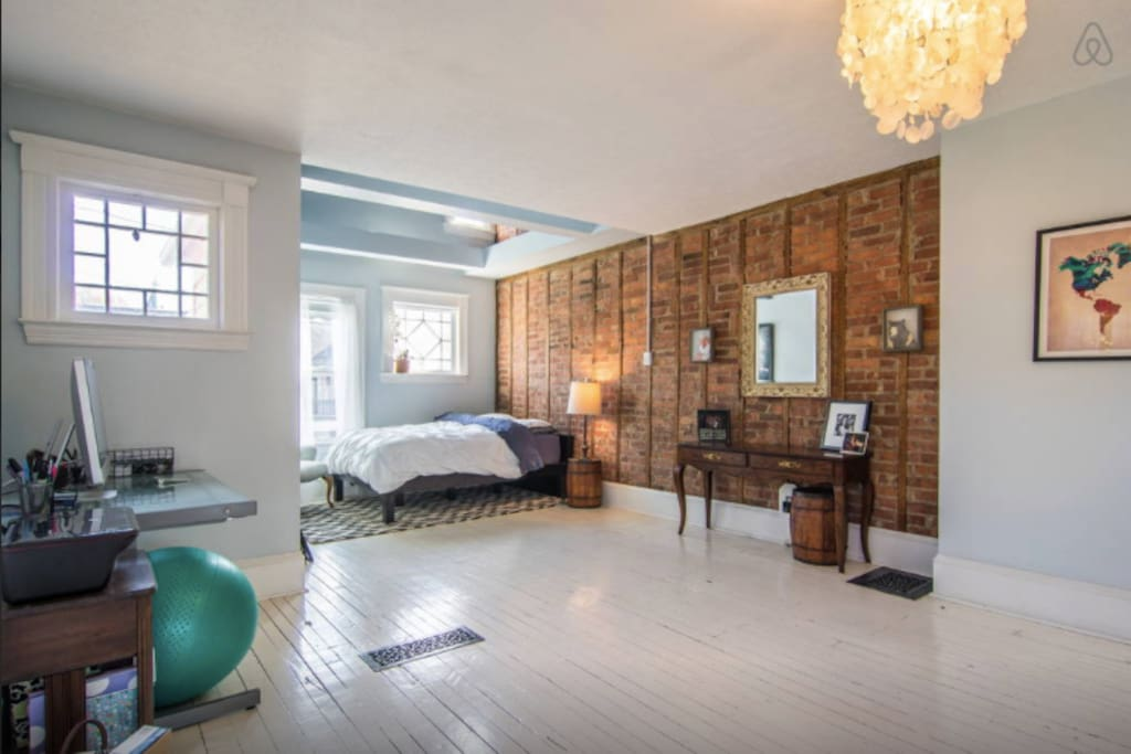 Exposed brick in bedroom