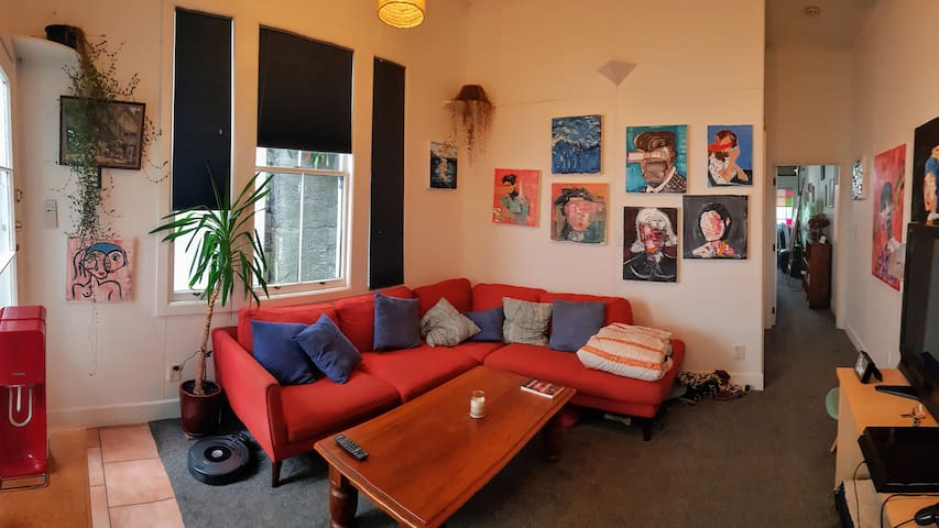 City based cosy room with art, garden and a dog