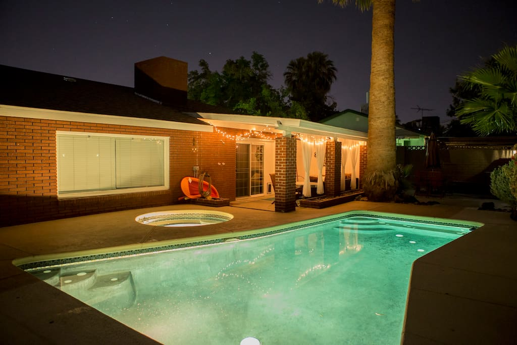 """Backyard at night """"Really quiet neighborhood and beautiful house, it was near the strip and downtown. All the equipment was provided to enjoy the vacation. The backyard patio is nice, really comfortable. Will definitely stay there again."""" -Omar R., Guest"""