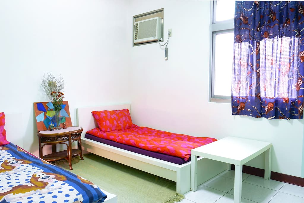 Two single-beds room for couple accommodation.