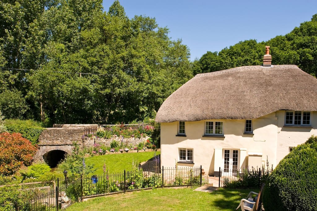 The beautiful garden and back view of cottage