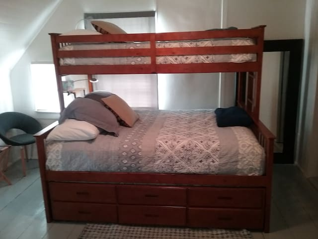 Bunk bed with queen size on bottom, extra long twin on top.