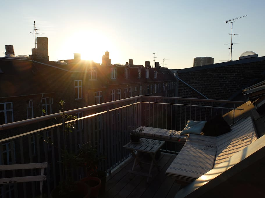 Sunset on private rooftop terrace