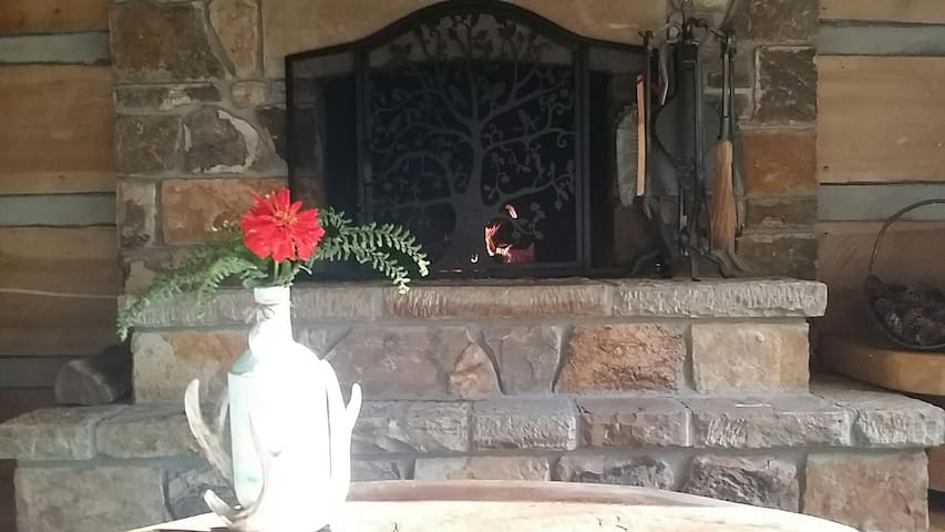 Stone fireplace, warm cherry mantel, raised height for viewing fire and a stone ledge for extra seating.